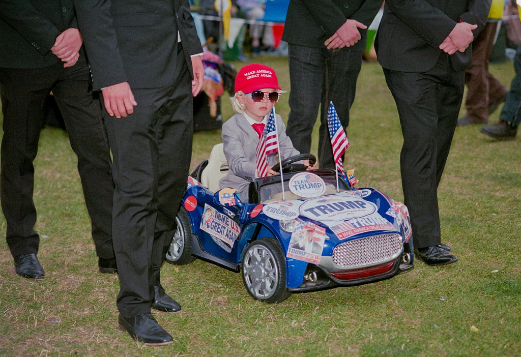 Donald Trump and entourage of bodyguards entry for the Wells Next The Sea carnival in Norfolk, August 2017.